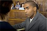 A male lawyer looking at another lawyer in a courtroom Stock Photo - Premium Royalty-Free, Artist: Arcaid, Code: 640-02767868