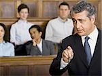 A male lawyer talking in a courtroom Stock Photo - Premium Royalty-Free, Artist: Jerzyworks, Code: 640-02767873