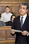 Close-up of a male lawyer talking in a courtroom Stock Photo - Premium Royalty-Freenull, Code: 640-02767874