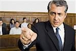 Portrait of a male lawyer pointing Stock Photo - Premium Royalty-Freenull, Code: 640-02767875