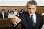 Portrait of a male lawyer pointing Stock Photo - Premium Royalty-Freenull, Code: 640-02767876