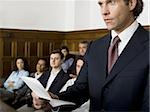 Juror standing in a jury box and reading the verdict Stock Photo - Premium Royalty-Free, Artist: Arcaid, Code: 640-02767879