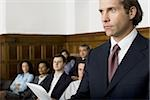 Juror standing in a jury box and reading the verdict Stock Photo - Premium Royalty-Free, Artist: Arcaid, Code: 640-02767880