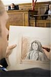 Close-up of a man drawing a sketch of a witness in a courtroom Stock Photo - Premium Royalty-Freenull, Code: 640-02767884