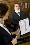 A female lawyer pointing at evidence in front of a victim in a courtroom Stock Photo - Premium Royalty-Freenull, Code: 640-02767886