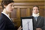 A female lawyer pointing at evidence in front of a victim in a courtroom Stock Photo - Premium Royalty-Freenull, Code: 640-02767888