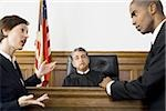 Two lawyers standing face to face in front of a male judge in a courtroom Stock Photo - Premium Royalty-Freenull, Code: 640-02767890