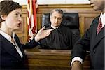 Two lawyers standing face to face in front of a male judge in a courtroom Stock Photo - Premium Royalty-Freenull, Code: 640-02767893