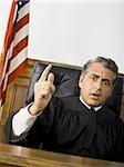 Portrait of a male judge pointing Stock Photo - Premium Royalty-Free, Artist: Arcaid, Code: 640-02767894