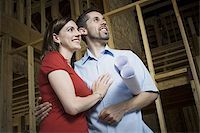 Low angle view of a young couple smiling Stock Photo - Premium Royalty-Freenull, Code: 640-02768138