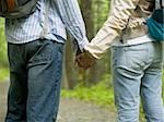 Mid section view of a young couple holding hands and standing Stock Photo - Premium Royalty-Free, Artist: Ty Milford, Code: 640-02768269