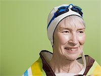 seniors and swim cap - Close-up of a senior woman wearing a swimming cap and swimming goggles Stock Photo - Premium Royalty-Freenull, Code: 640-02768331