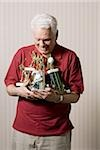 Portrait of a senior man holding trophies Stock Photo - Premium Royalty-Free, Artist: Arcaid, Code: 640-02768335
