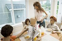 female rear end - Four mannequins portraying a family at the dining table Stock Photo - Premium Royalty-Freenull, Code: 640-02768359