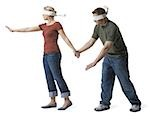 Blindfolded young woman leading to a blindfolded young man Stock Photo - Premium Royalty-Free, Artist: Aurora Photos, Code: 640-02768404