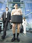 Low angle view of a naked man holding a briefcase Stock Photo - Premium Royalty-Free, Artist: CulturaRM, Code: 640-02768421