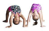 Young female gymnasts bending backwards Stock Photo - Premium Royalty-Freenull, Code: 640-02768443