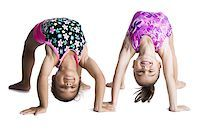 Young female gymnasts bending backwards Stock Photo - Premium Royalty-Freenull, Code: 640-02768444