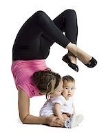 Contortionist mother with baby daughter Stock Photo - Premium Royalty-Freenull, Code: 640-02768483