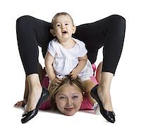 Contortionist mother with baby daughter Stock Photo - Premium Royalty-Freenull, Code: 640-02768485