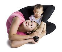 Contortionist mother with baby daughter Stock Photo - Premium Royalty-Freenull, Code: 640-02768486