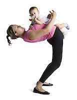 Contortionist mother with baby daughter Stock Photo - Premium Royalty-Freenull, Code: 640-02768488
