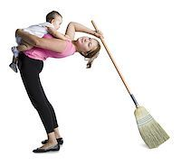 Contortionist mother sweeping while holding baby daughter Stock Photo - Premium Royalty-Freenull, Code: 640-02768496