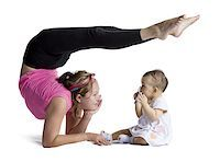 Contortionist mother with baby daughter Stock Photo - Premium Royalty-Freenull, Code: 640-02768499