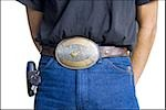 Midsection of slender young man wearing a big belt buckle Stock Photo - Premium Royalty-Free, Artist: Aflo Sport, Code: 640-02768537