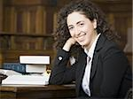 Female lawyer smiling in courtroom Stock Photo - Premium Royalty-Freenull, Code: 640-02768826