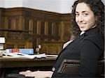 Female lawyer smiling in courtroom Stock Photo - Premium Royalty-Freenull, Code: 640-02768827