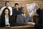 Lawyer presenting evidence to jurors Stock Photo - Premium Royalty-Freenull, Code: 640-02768832