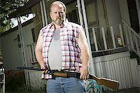 Overweight man with a shotgun Stock Photo - Premium Royalty-Freenull, Code: 640-02769446