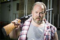 Overweight man with a shotgun Stock Photo - Premium Royalty-Freenull, Code: 640-02769449