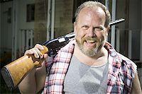 Overweight man with a shotgun Stock Photo - Premium Royalty-Freenull, Code: 640-02769450