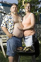 Overweight couple in a trailer park Stock Photo - Premium Royalty-Freenull, Code: 640-02769464