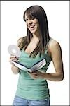 Young woman holding a DVD Stock Photo - Premium Royalty-Free, Artist: Ikon Images, Code: 640-02769577