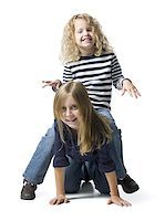 female white background full body - Two girls playing together Stock Photo - Premium Royalty-Freenull, Code: 640-02769643