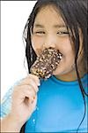 Overweight young girl eating ice cream bar Stock Photo - Premium Royalty-Free, Artist: Push Pictures, Code: 640-02769662