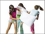 Three girls pillow fighting Stock Photo - Premium Royalty-Free, Artist: Graham French, Code: 640-02769841