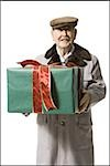 Older man holding present Stock Photo - Premium Royalty-Freenull, Code: 640-02770000