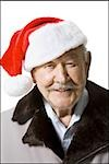 Older man wearing Santa hat Stock Photo - Premium Royalty-Freenull, Code: 640-02770002