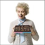 Older woman holding a box of chocolates Stock Photo - Premium Royalty-Free, Artist: Arcaid, Code: 640-02770004
