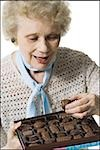 Older woman holding a box of chocolates Stock Photo - Premium Royalty-Free, Artist: Arcaid, Code: 640-02770007