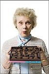 Older woman holding a box of chocolates Stock Photo - Premium Royalty-Free, Artist: Masterfile, Code: 640-02770009