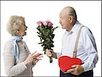 Older man giving wife Valentines chocolate Stock Photo - Premium Royalty-Free, Artist: Arcaid, Code: 640-02770010