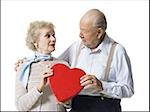 Older man giving wife Valentines chocolate Stock Photo - Premium Royalty-Free, Artist: Arcaid, Code: 640-02770012