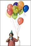 Young boy with balloons Stock Photo - Premium Royalty-Free, Artist: Tom Feiler, Code: 640-02770213
