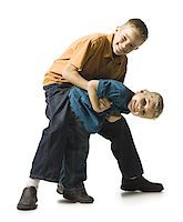 Two brothers wrestling and play fighting Stock Photo - Premium Royalty-Freenull, Code: 640-02770460