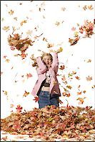pile leaves playing - Young girl playing in fallen leaves Stock Photo - Premium Royalty-Freenull, Code: 640-02770474